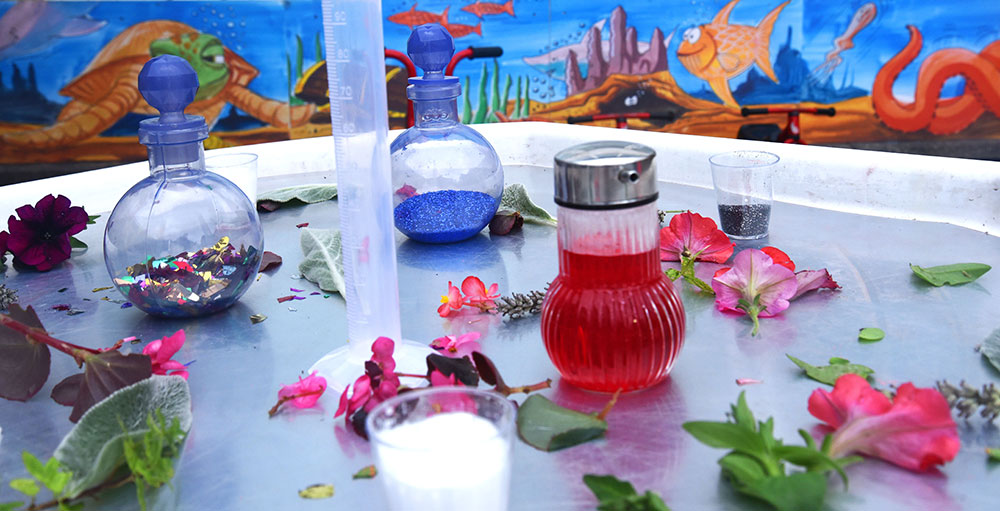Colourful potion making items on a table